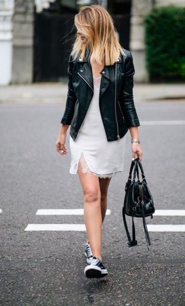 فستان أبيض مع جاكيت جلد