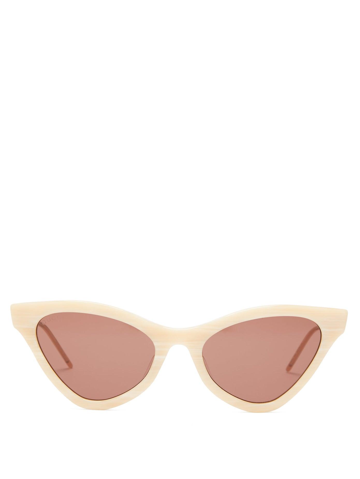 نظارات شمسية بإطارات عريضة باللون الوردي الزاهي من Gucci