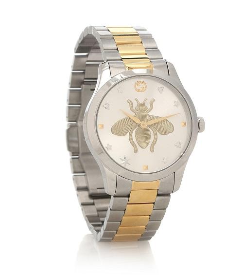 ساعة من الفضة والذهب الأصفر بتصميم انيق من Gucci