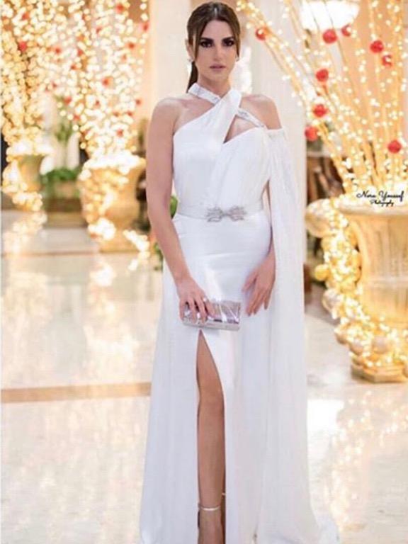 درة زروق في فستان أبيض