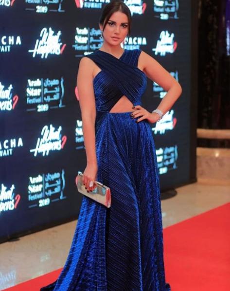 درة زروق متألقة في فستان أزرق من ليث معلوف