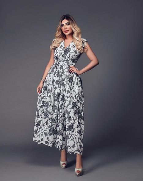 فستان ماكسي معرق اختارته أمل العوضي