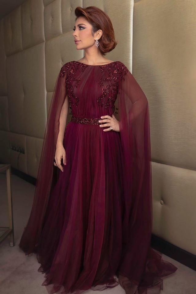 احدى أجمل اطلالات أصالة هذا العام في فستان باللون العنابي