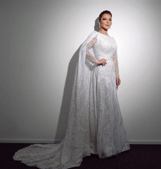 تألقت أصالة في فستان باللون الأبيض من نيكولا جبران