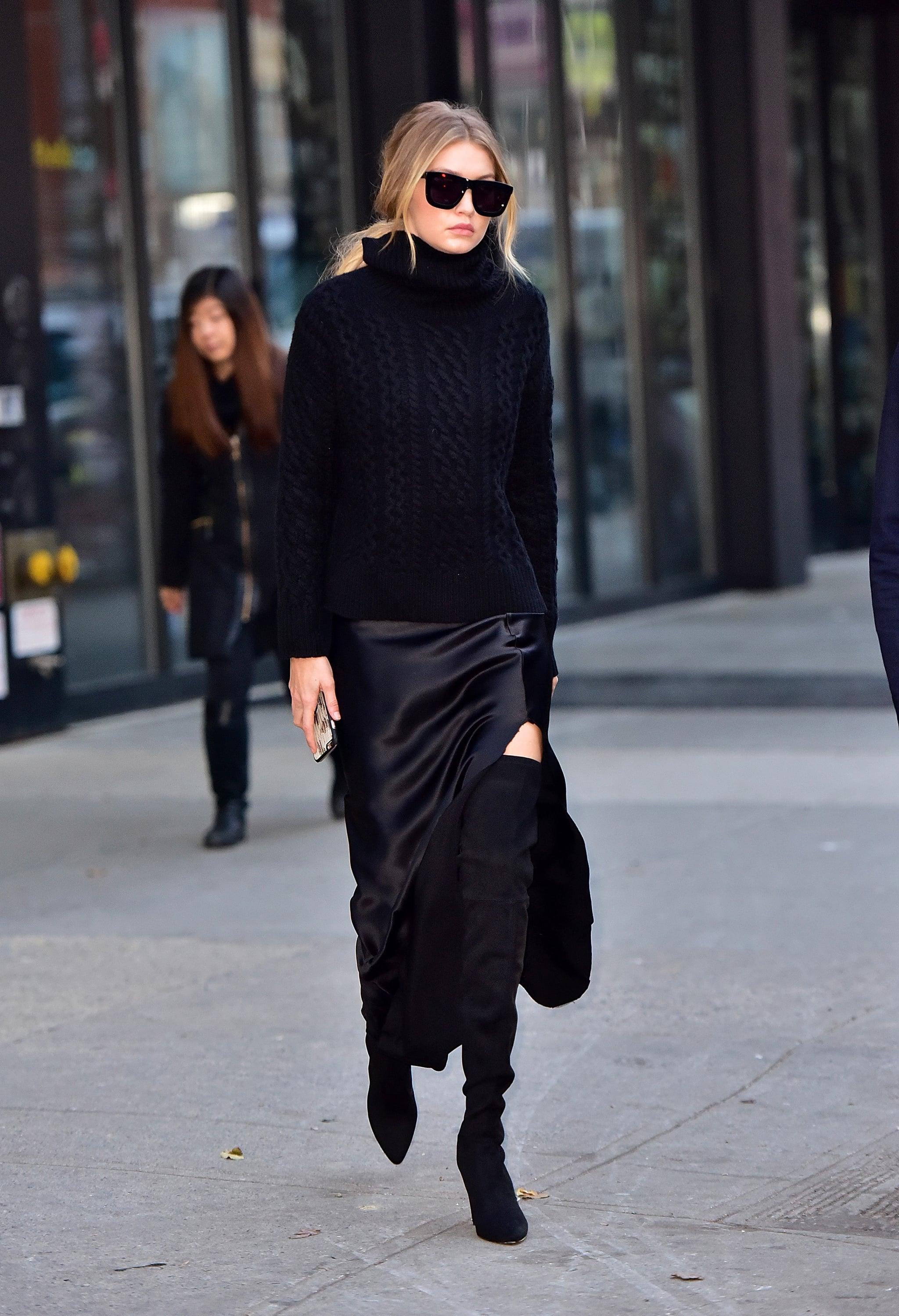تنورة ميدي من الساتان الأسود نسقتها جيجي حديد لاطلالة شبابية