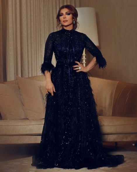 أصالة نصري في فستان أسود بتصميم فاخر