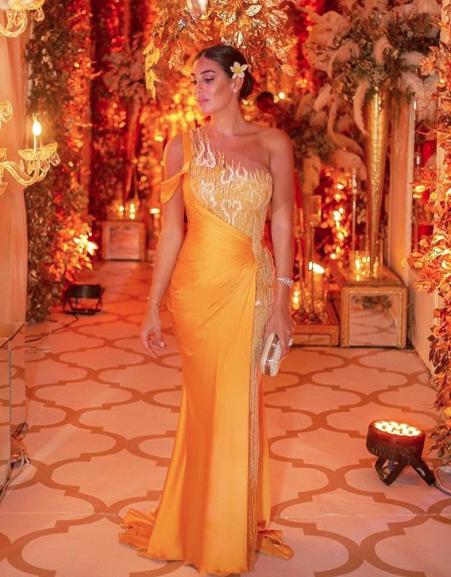 ياسمين صبري في فستان أصفر من أنطوان قارح