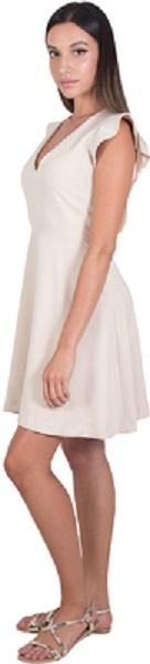 فستان قصير باللون الأبيض بدون أكمام من كوكا