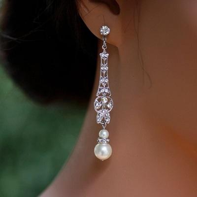 تصميم فاخر لأقراط طويلة ناعمة من الماس واللؤلؤ
