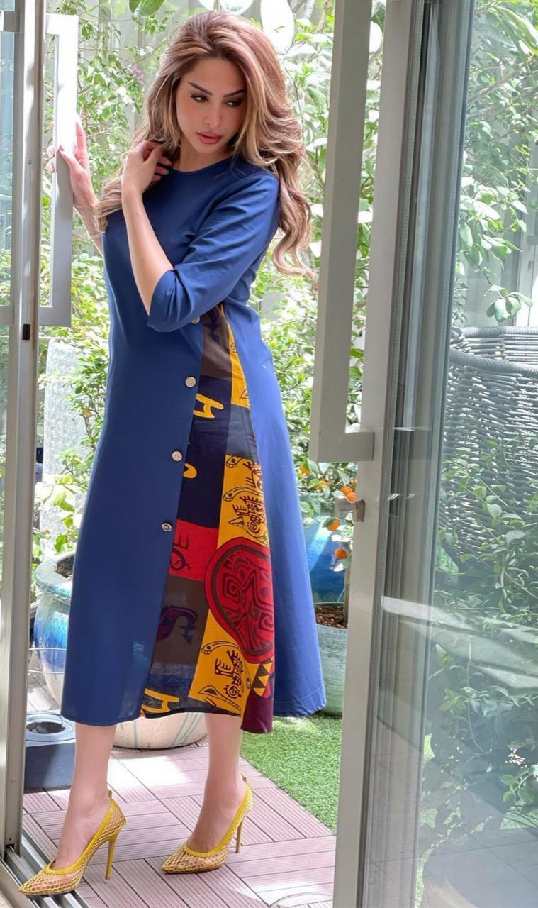 7 فستان رمضاني ازرق لاخفاء عيوب الجسم -الصورة من حسابها على الانستغرام