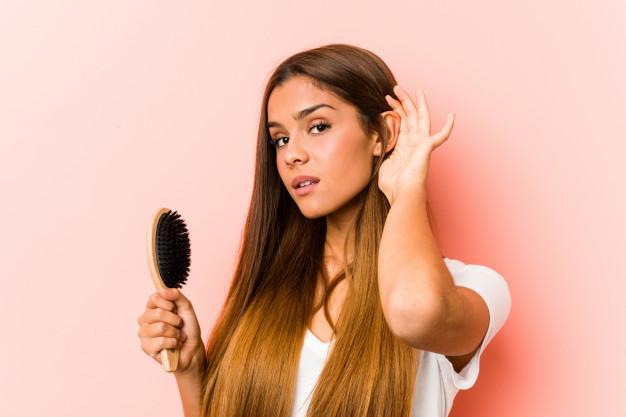 young caucasian woman holding hairbrush trying listening gossip 1187 49657 - أفضل بلسم للشعر..ستعجبك النتائج