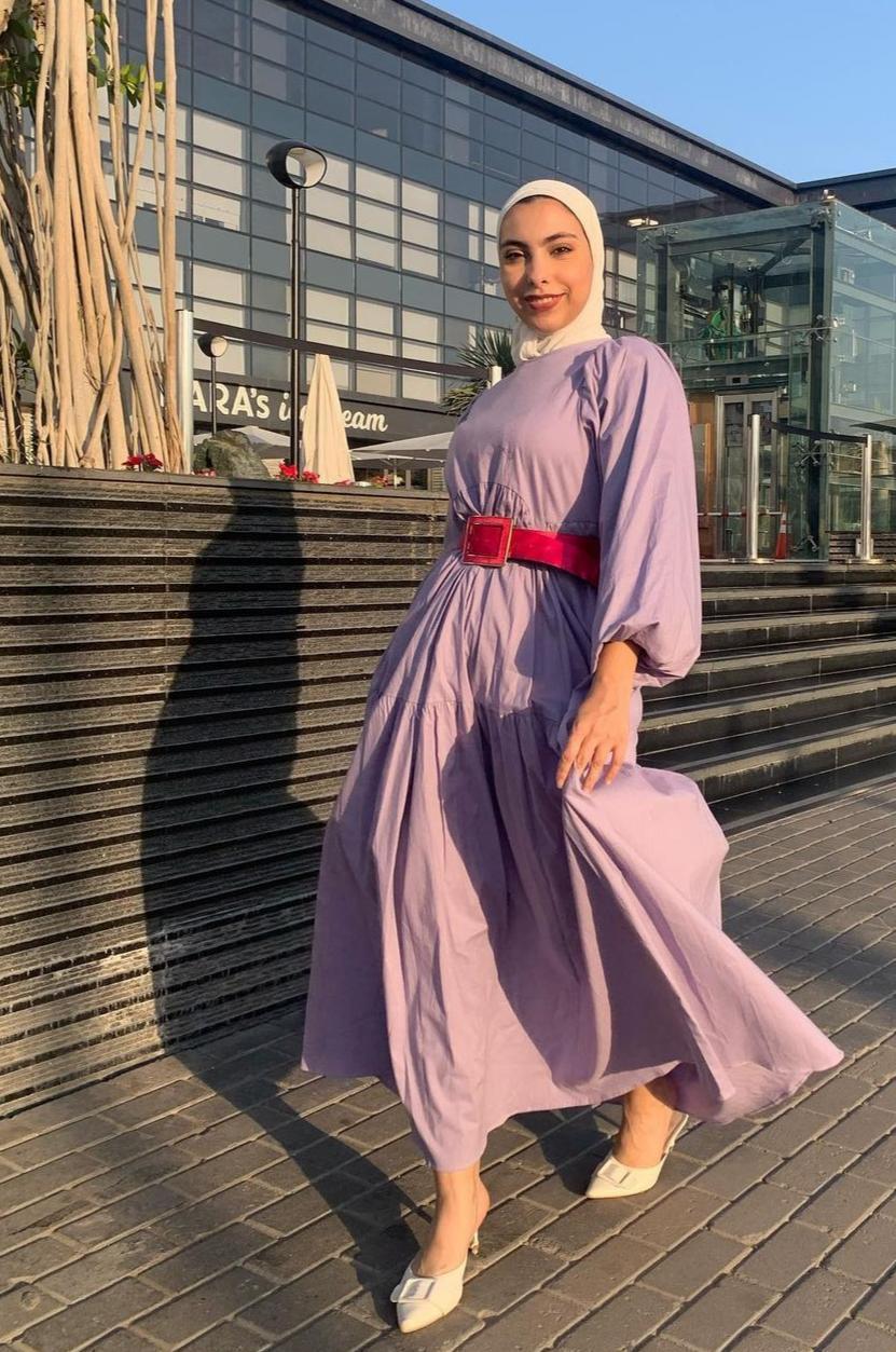 1 صفا غالي بفستان بنفسجي عصري -الصورة من حسابها على الانستغرام