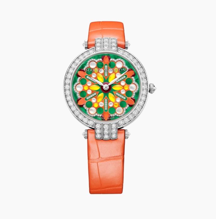 """ساعة يد فاخرة باللون البرتقالي من ماركة هاري وينستون """"Harry Winston"""""""