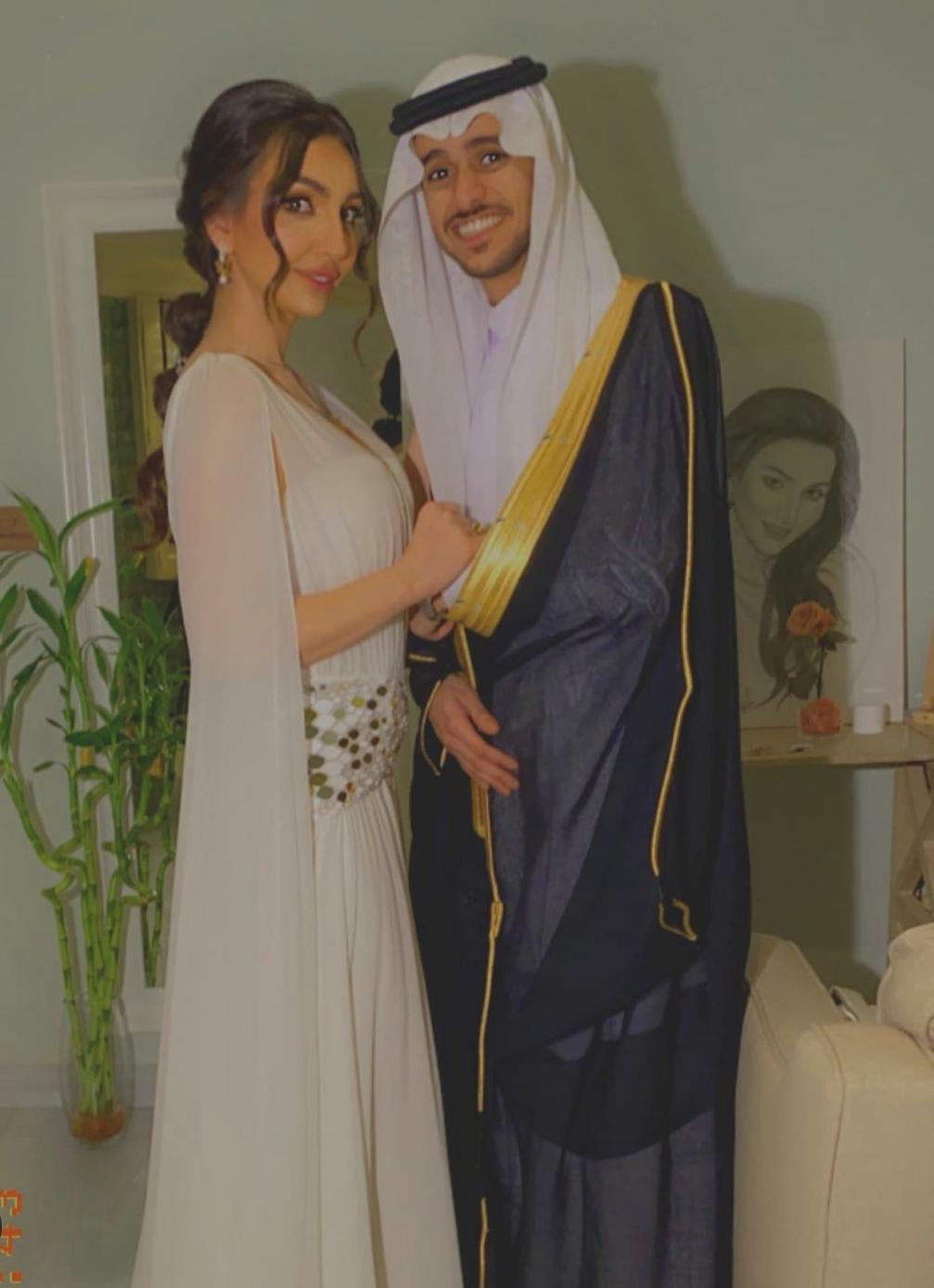 عايض وزوجته هبه الحسين
