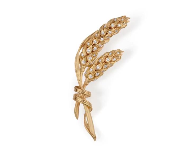 بروش من الذهب الأصفر مرصّع بالألماس من شوميه Chaumet